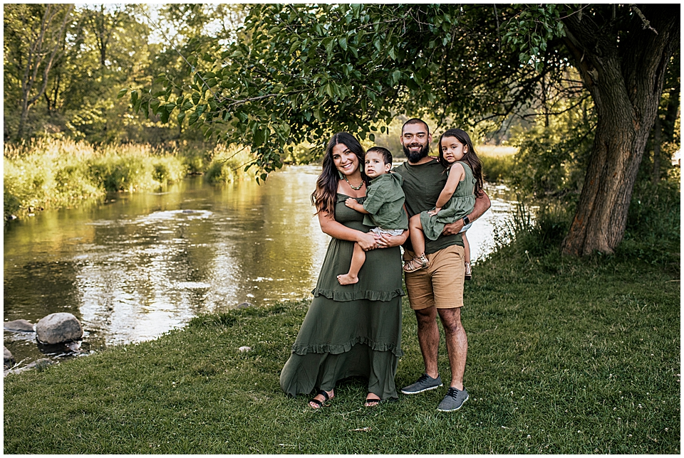 family of four by the river
