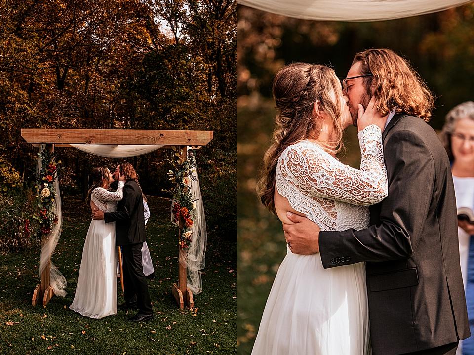 first kiss at intimate backyard autumn wedding