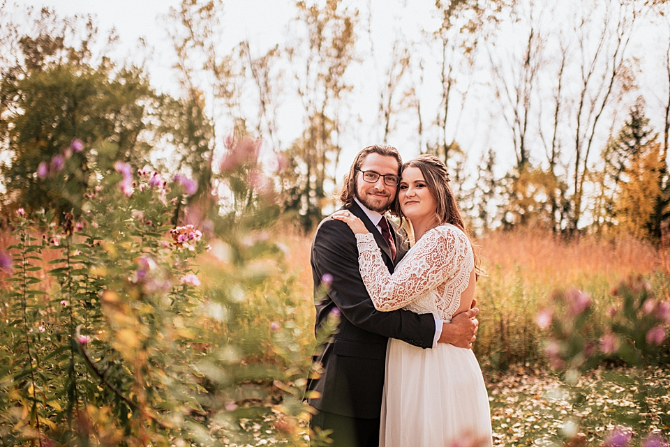 bride and groom in the fall foliage