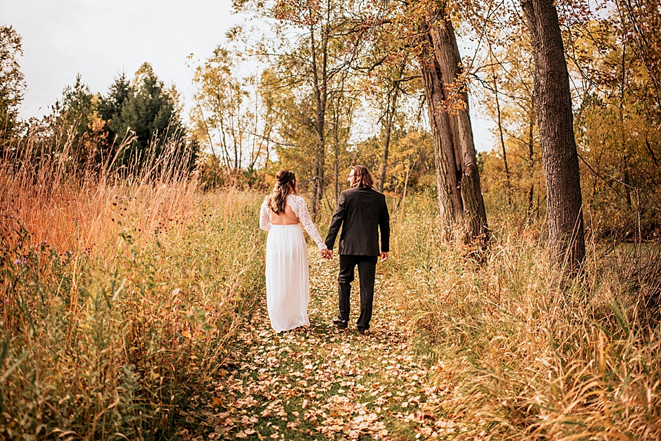 bride and groom in the autumn foliage