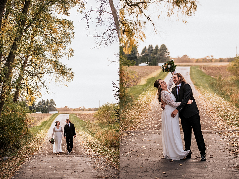 couple kissing on a wooded road
