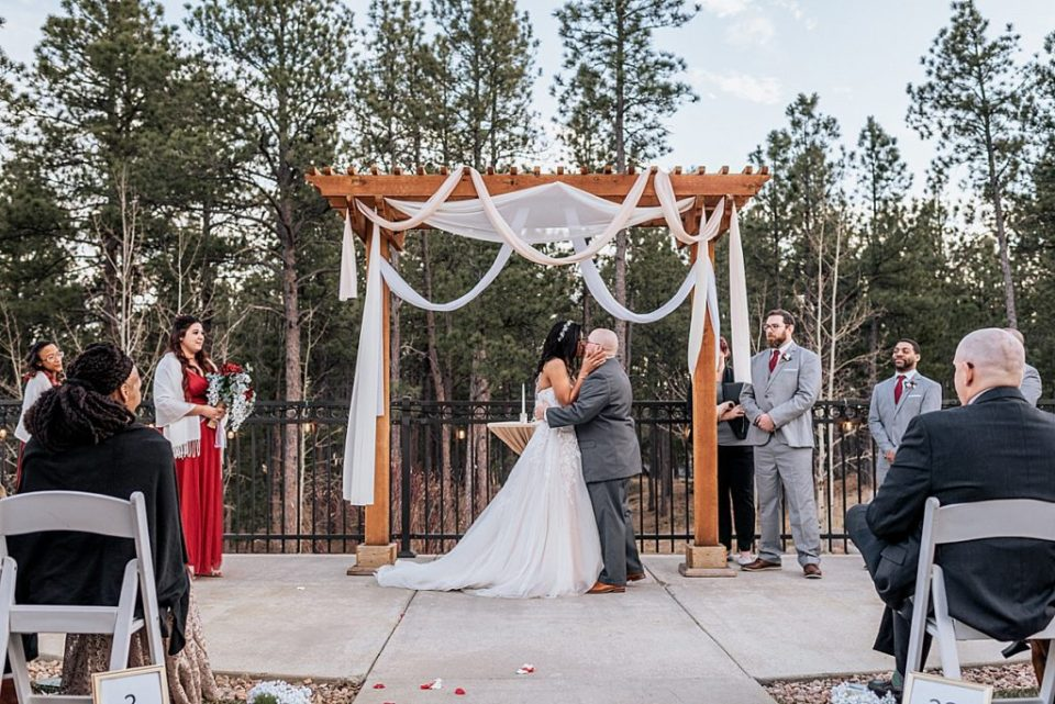 first kiss at wedgewood black forest wedding outdoor ceremony