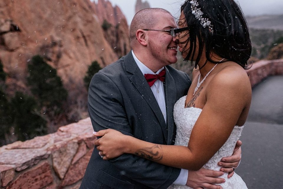 bride and groom giving each other eskimo kisses
