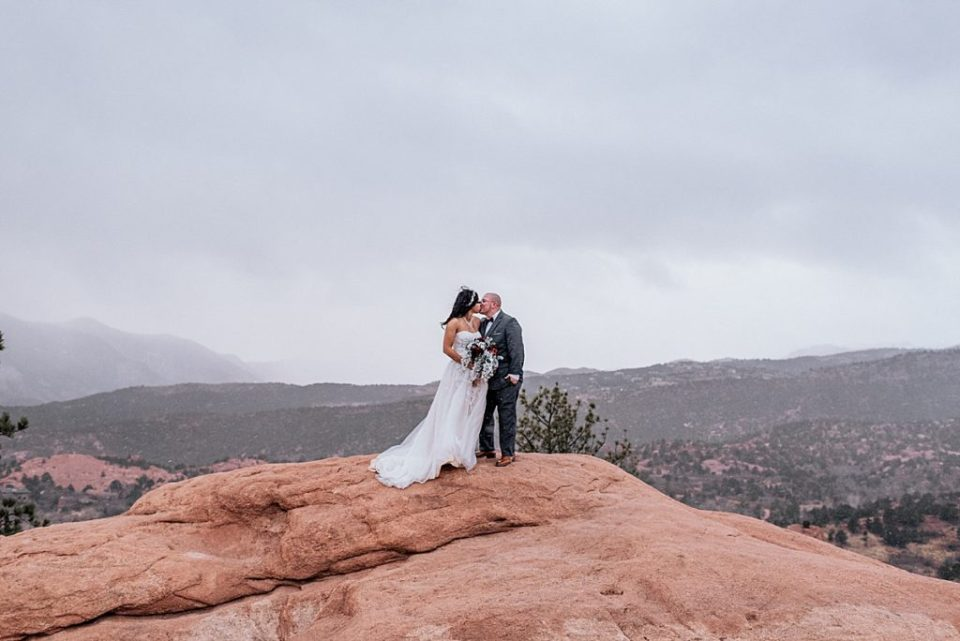 bride and groom at high point at garden of the gods