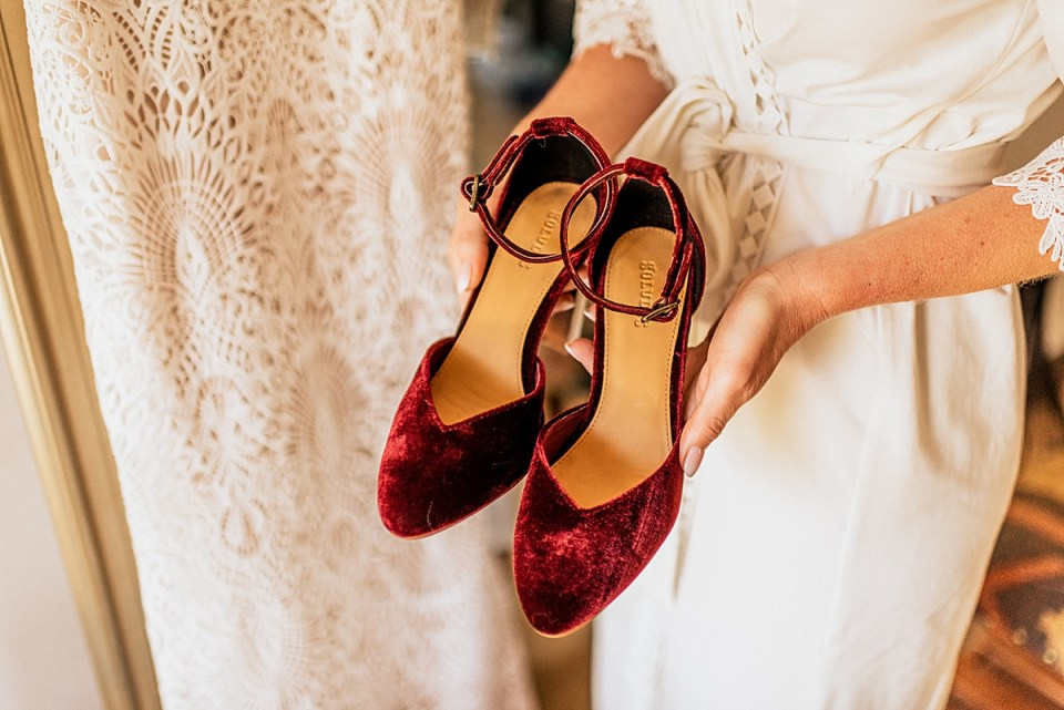 bride holding platform heels