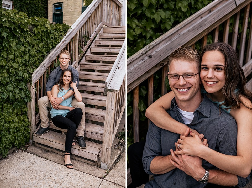 engaged couple sitting on wood stairs together downtown burlington engagement session