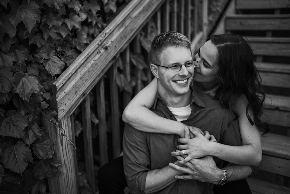 woman snuggling into fiance and laughing together