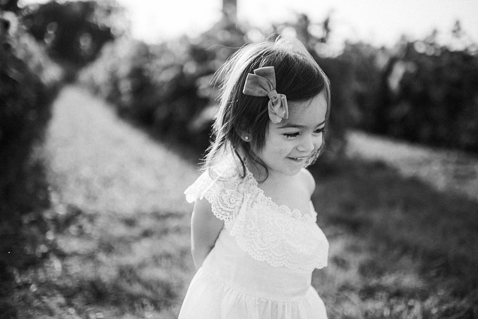 18 month old girl in sunflower field