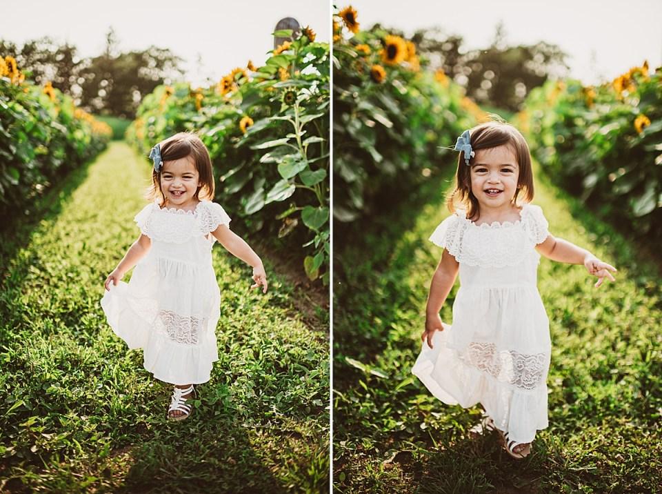 toddler running through a sunflower field