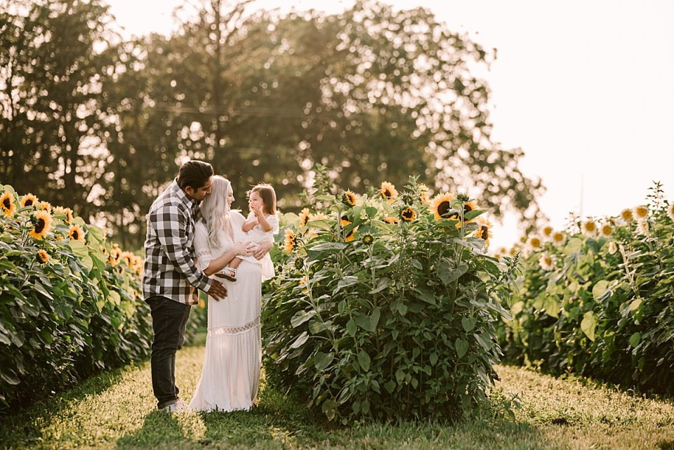 maternity photos in a summer field of sunflowers