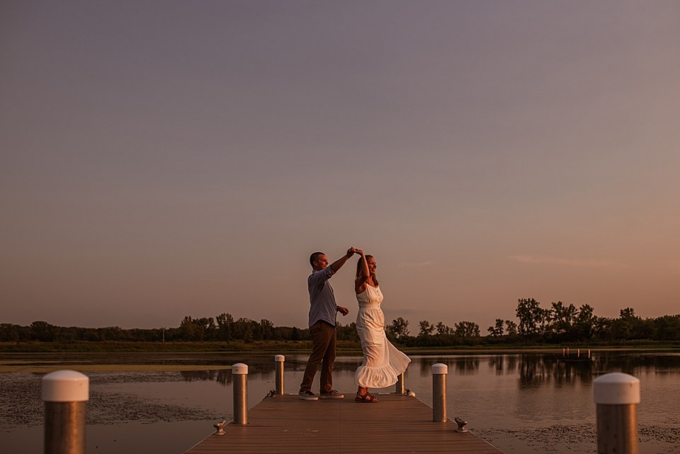 couple dancing at sunset at the end of the pier at bong recreation state park