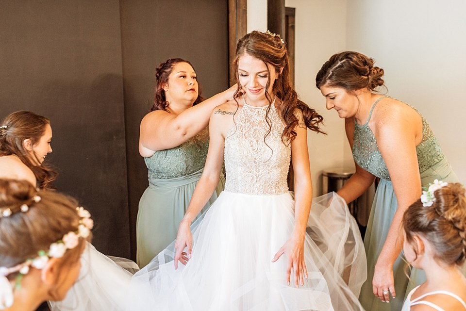 bride getting ready with her bridesmaids