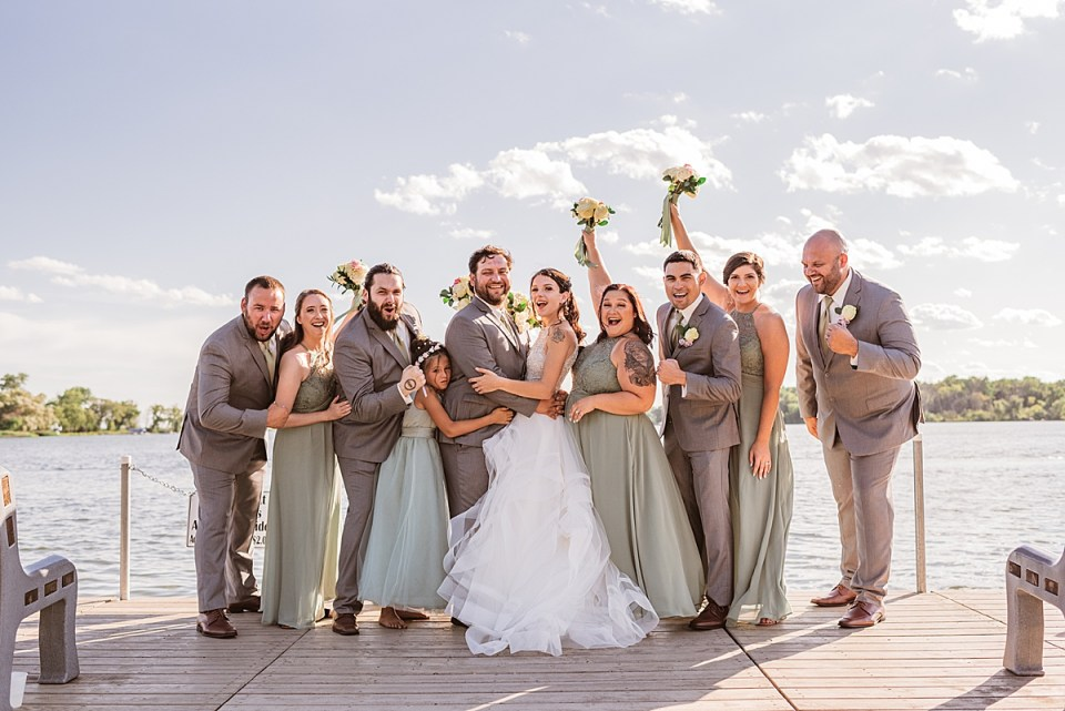 wedding party at the end of the pier for bass bay brewhouse wedding in muskego wisconsin