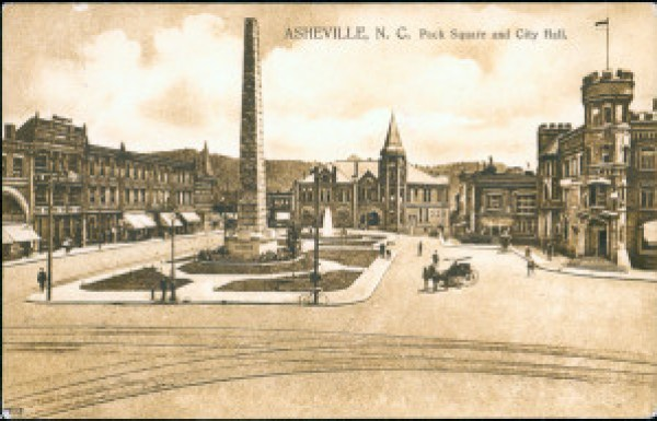 Court Square (called Pack Square here, though it did not carry that name until the 1920s). Streetcar tracks in foreground. Pack Memorial Public Library.