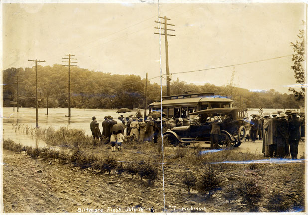 Street car at flooded French Broad River in Biltmore, July 16, 1916. Pack Memorial Public Library