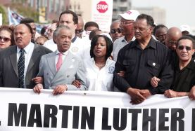 Martiin Luther King III, Rev. Al Sharpton, Roslyn M. Brock and Rev. Jesse Jackson (2nd-R) march in the 50th Anniversary Commemorative Freedom Walk June 22, 2013