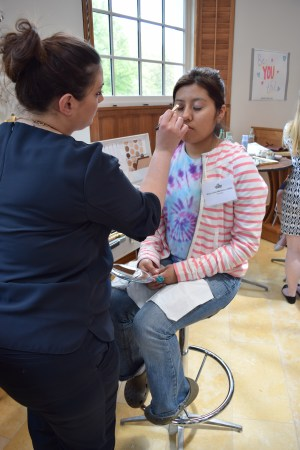 Cummings High School student getting her makeup done for free, Photo: Caroline Dean