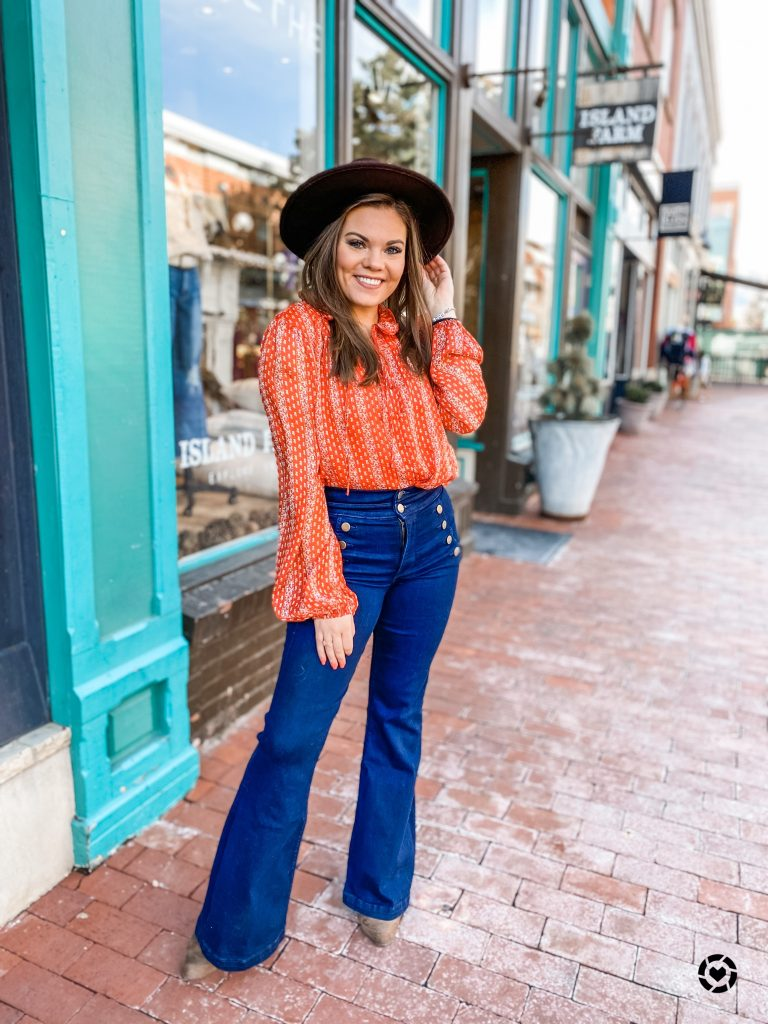 Red blouse and flare denim what to wear on Valentine's Day