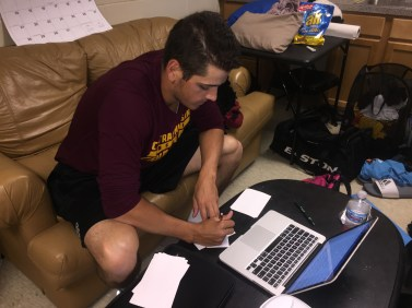 Sophomore baseball pitcher, Michael Brettell, studies in his dorm to keep up with his school work.