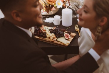 Charcuterie board detail with bride and groom | Wedding portraits | Elopement portraits | Bride and groom elopement photos | Elopement wedding photos in Colorado | Colorado wedding photos | Colorado elopement photos | Elopement at Treehaus, Colorado | Treehaus Colorado | Colorado elopement | Treehaus elopement | Colorado elopement venue | Colorado mountain elopement venue | Unique elopement venue | Elopement venue in Colorado | Ashley Joyce Photography 2020
