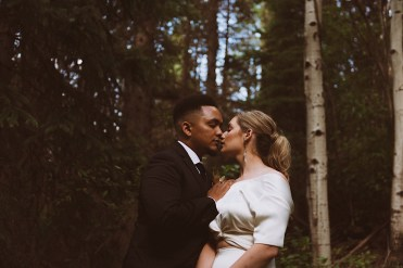 Bride and groom snuggling nose to nose in the woods of Colorado | Wedding portraits | Elopement portraits | Bride and groom elopement photos | Elopement wedding photos in Colorado | Colorado wedding photos | Colorado elopement photos | Elopement at Treehaus, Colorado |  Treehaus Colorado | Colorado elopement | Treehaus elopement | Colorado elopement venue | Colorado mountain elopement venue | Unique elopement venue | Elopement venue in Colorado | Ashley Joyce Photography 2020