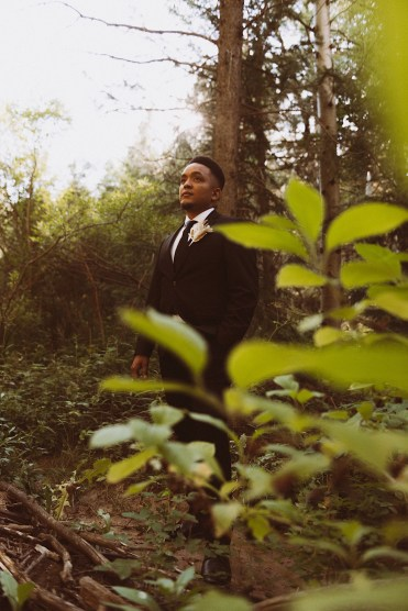 Groom standing in the forest in Colorado | Groom attire | Wedding portraits | Elopement portraits | Bride and groom elopement photos | Elopement wedding photos in Colorado | Colorado wedding photos | Colorado elopement photos | Elopement at Treehaus, Colorado |  Treehaus Colorado | Colorado elopement | Treehaus elopement | Colorado elopement venue | Colorado mountain elopement venue | Unique elopement venue | Elopement venue in Colorado | Ashley Joyce Photography 2020