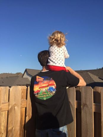 Reagan and Daddy creeping on the neighbors