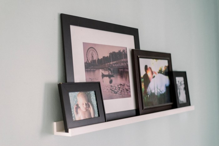 Display your family portraits on a frame ledge for a modern look.