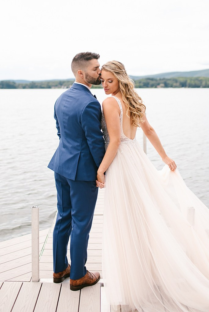 romantic wedding portraits along lake with Ashley Mac Photographs