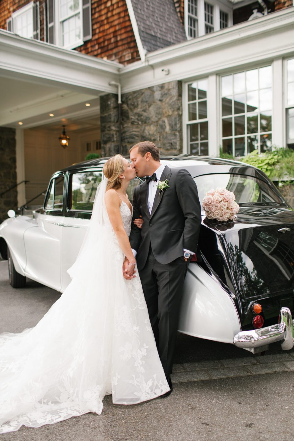 Ashley Mac Photographs captures bride and groom by classic car