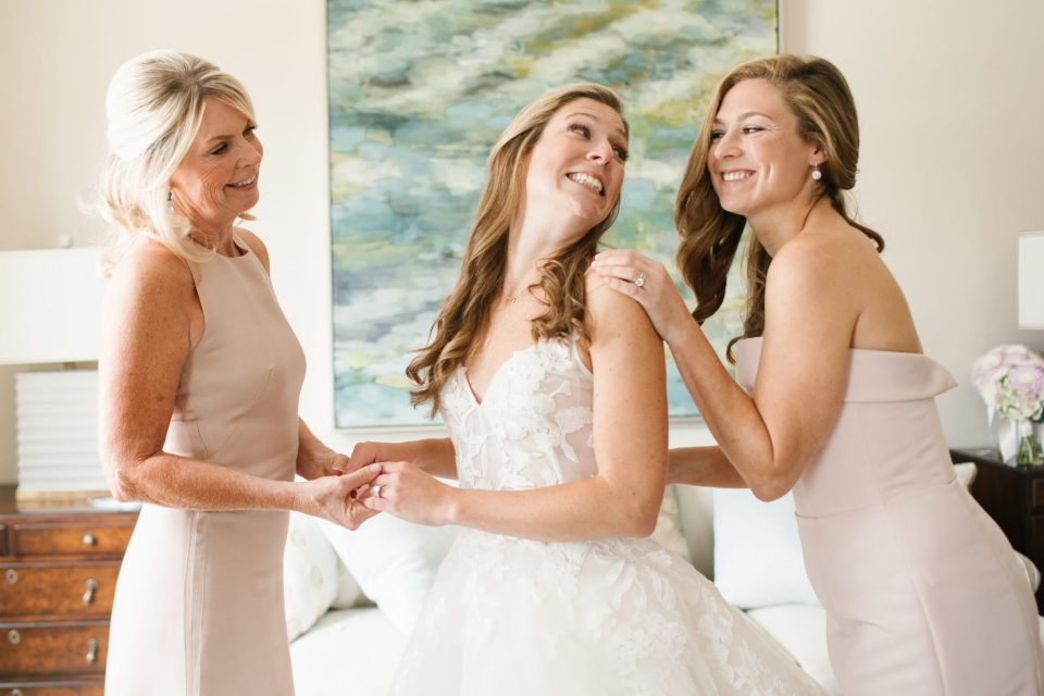 bride and bridesmaids prepare for The Apawamis Club Wedding photographed by Ashley Mac Photographs