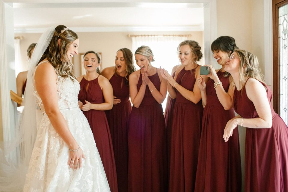 first look with bridesmaids photographed by Ashley Mac Photographs