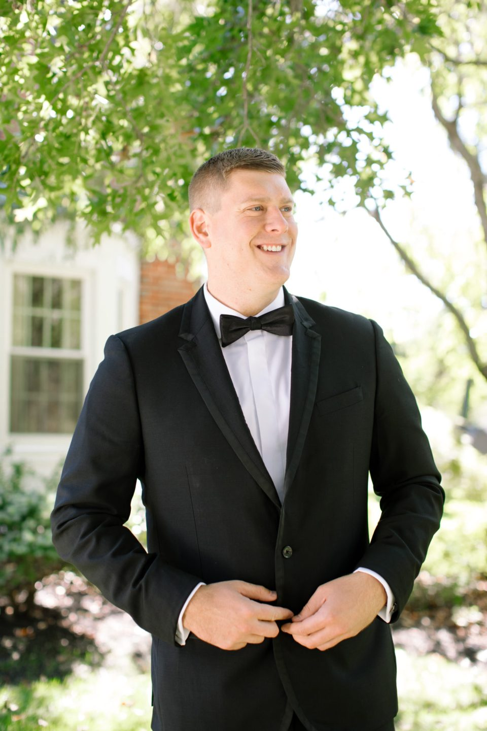 groom in black tux photographed by NJ wedding photographer Ashley Mac Photographs