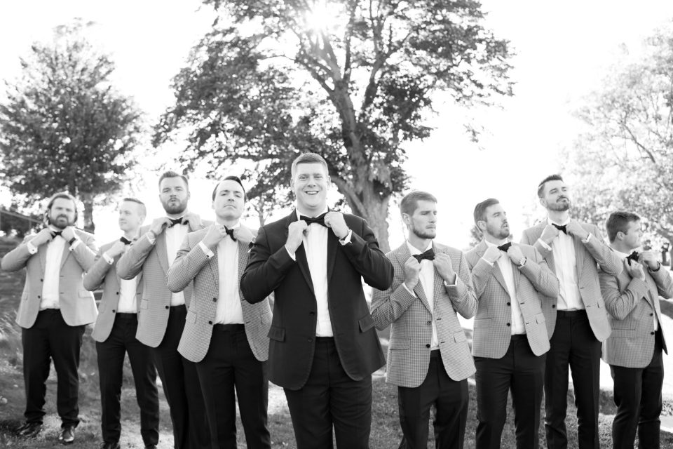 groom and groomsmen pose for Ashley Mac Photographs in NJ