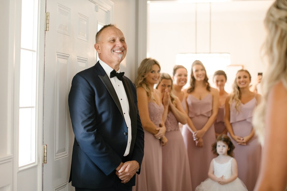 dad waits to see daughter for first look photographed by Ashley Mac Photographs