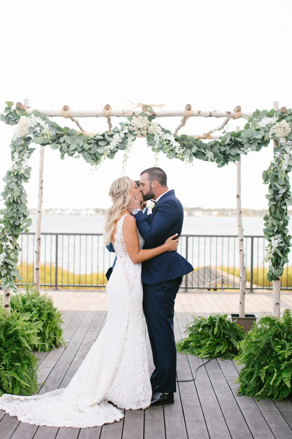 first kiss as husband and wife at Rumson Country Club Riverhouse with Ashley Mac Photographs