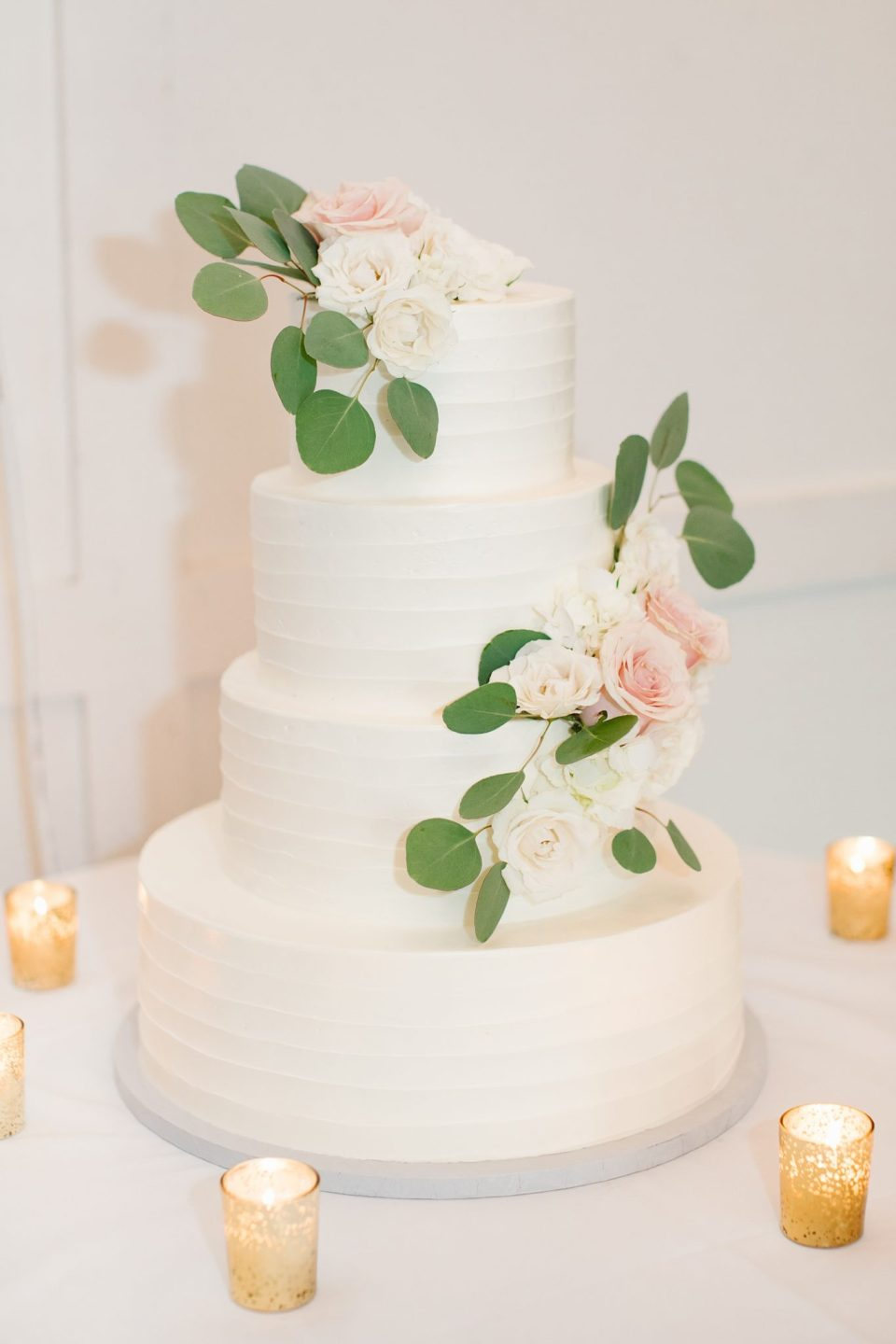 tiered wedding cake at Rumson Country Club Riverhouse with Ashley Mac Photographs