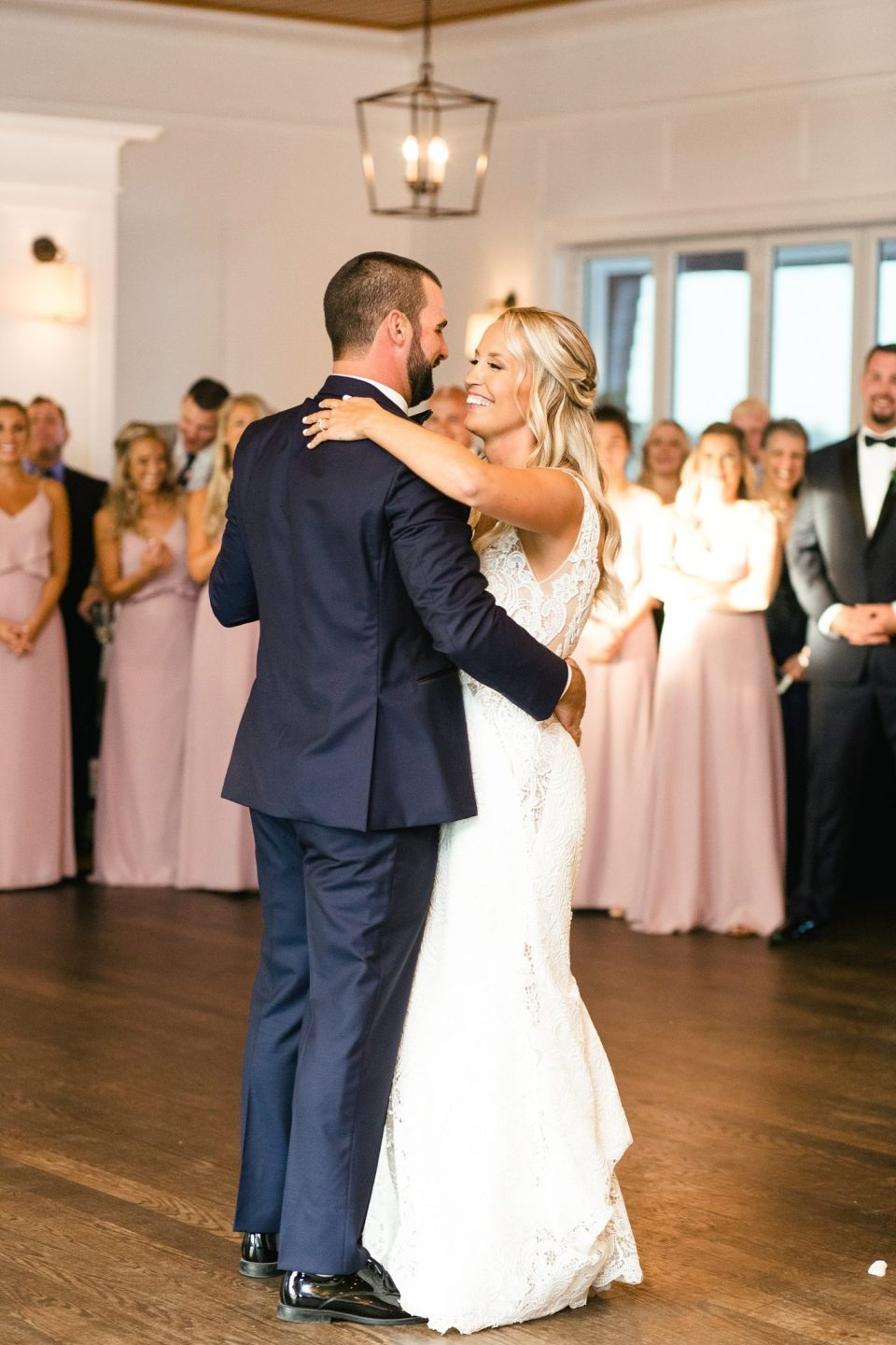 first dance at Rumson Country Club Riverhouse wedding reception photographed by Ashley Mac Photographs