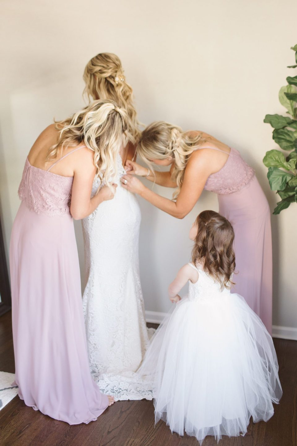 flower girl watches bride get into wedding dress photographed by Ashley Mac Photographs for Rumson Country Club Riverhouse wedding