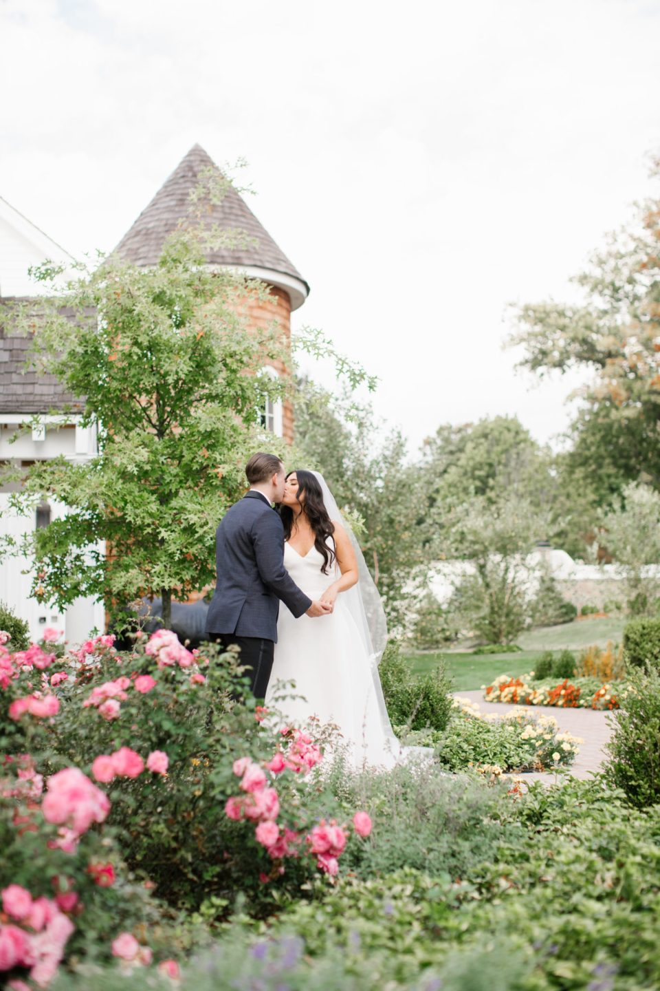 Ashley Mac Photographs photographs happy couple in garden at Ryland Inn