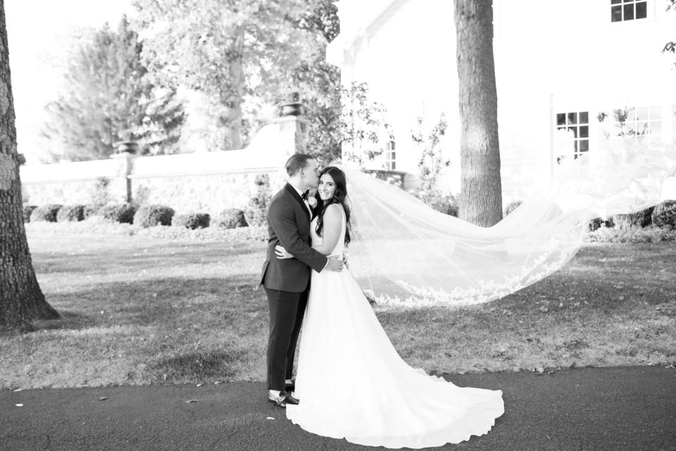 Ashley Mac Photographs photographs bride and groom at Ryland Inn