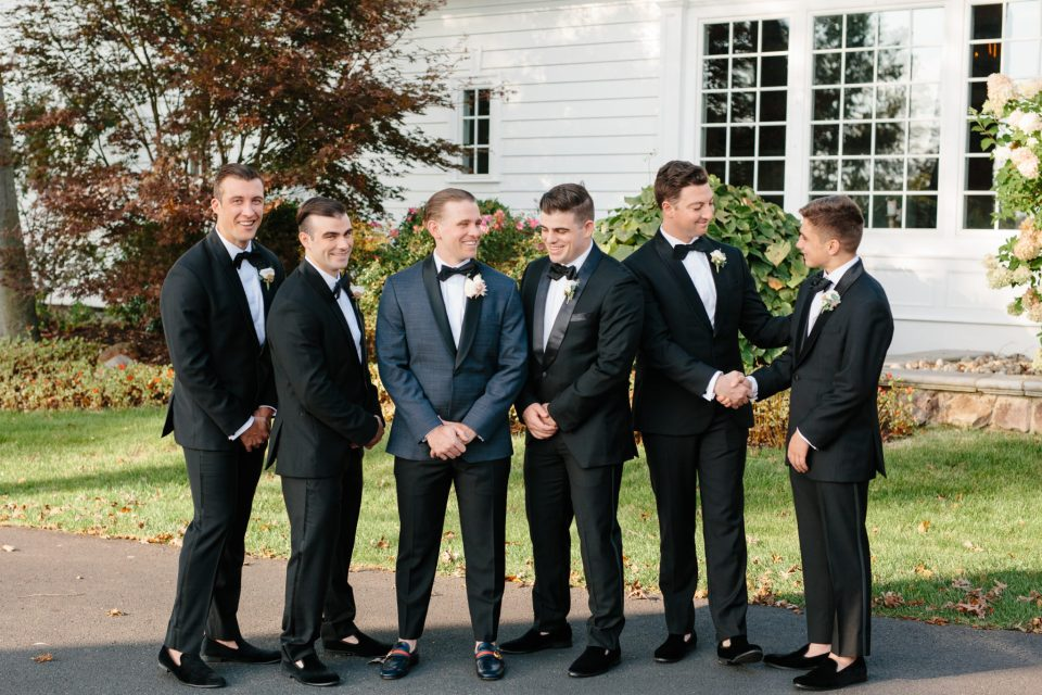 groomsmen in suits from the Black Tux photographed by Ashley Mac Photographs