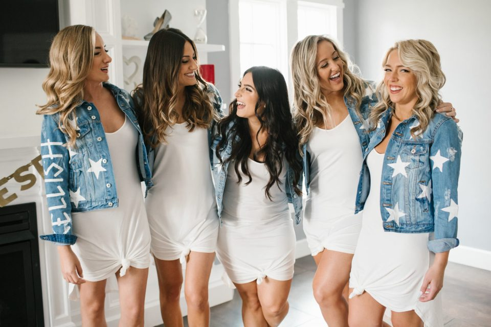 bridesmaids in custom jean jackets photographed by Ashley Mac Photographs