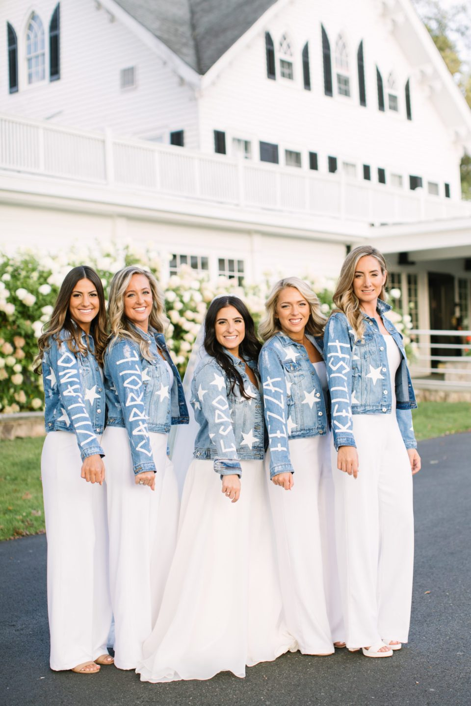 bridesmaids and bride in custom jean jackets with Ashley Mac Photographs
