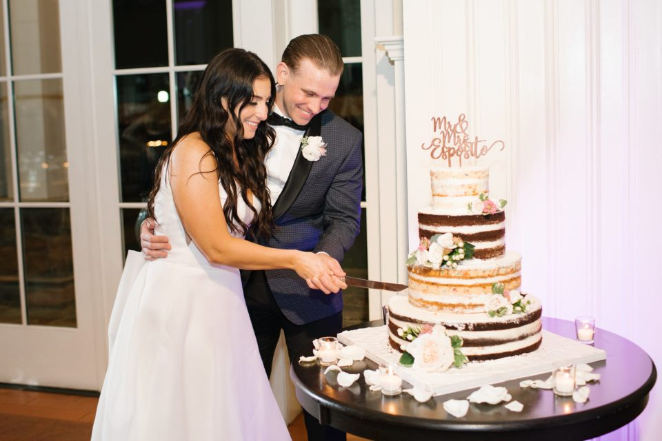 bride and groom cut cake from Palmero's Bakery photographed by Ashley Mac Photographs