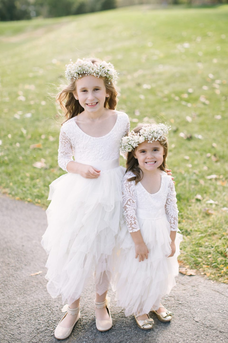 flower girls in white with flower crowns for West Hills Country Club wedding day