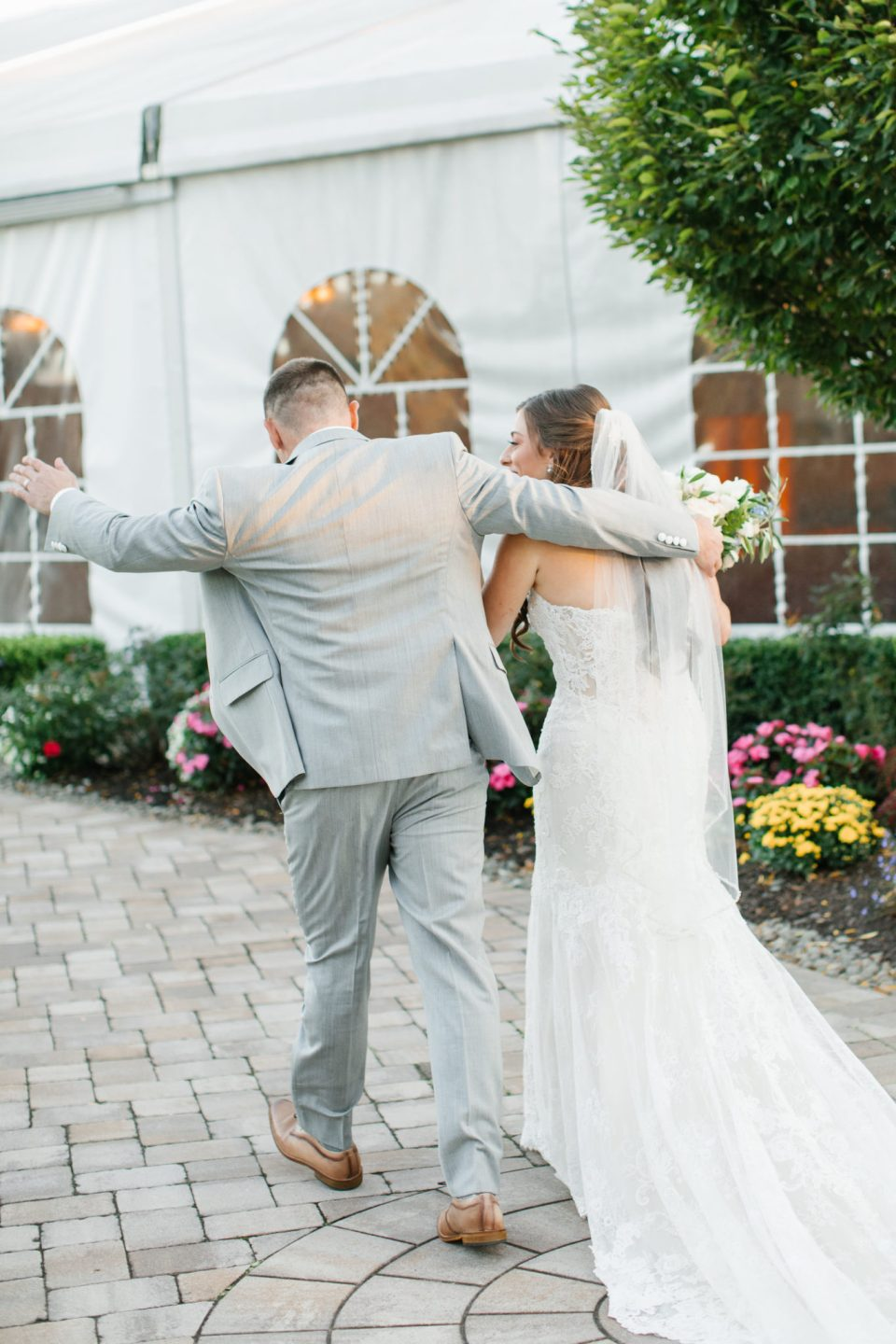 bride and groom dance out of wedding ceremony photographed by Ashley Mac Photographs