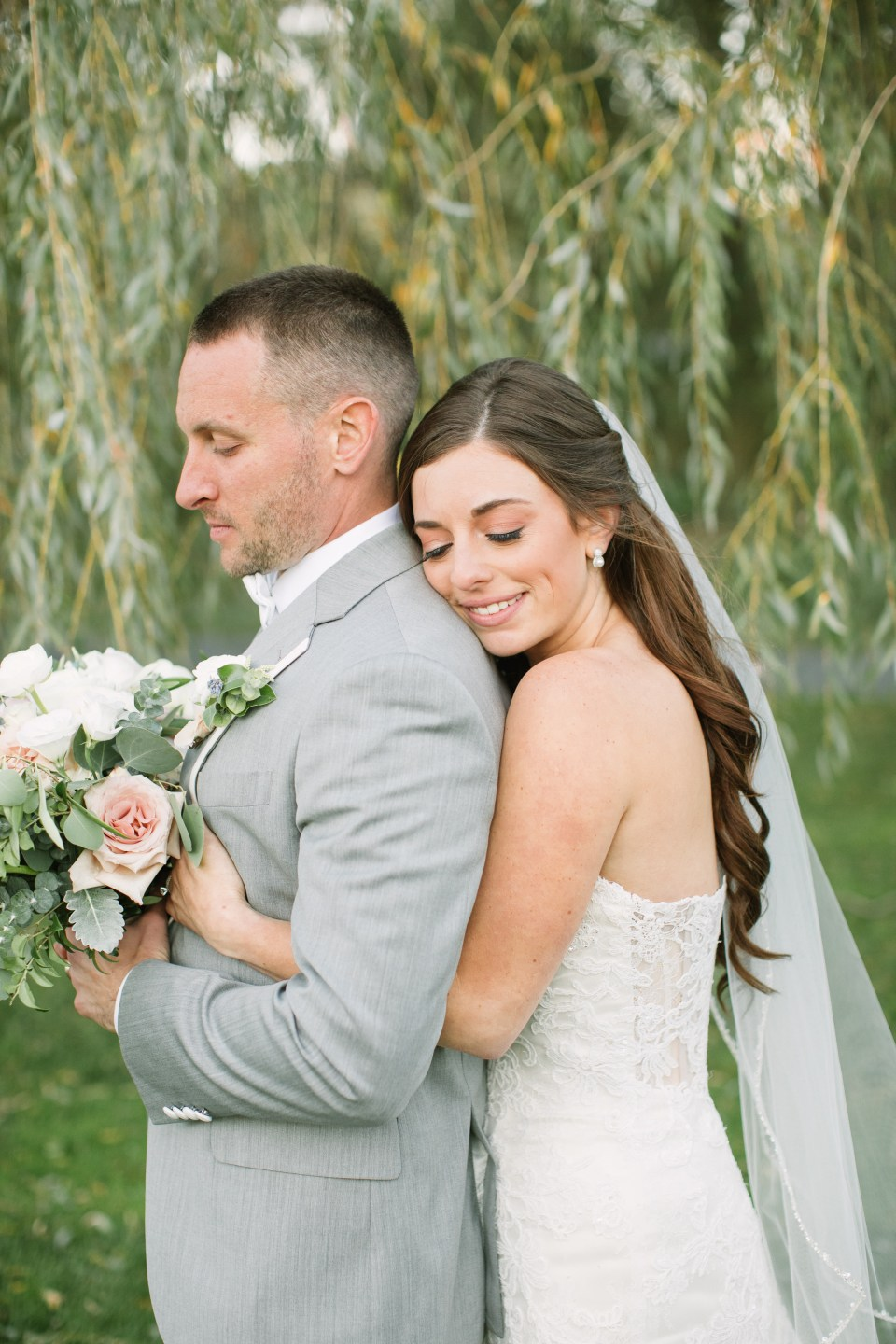 Ashley Mac Photographs photographs bride and groom on their wedding day in New Jersey