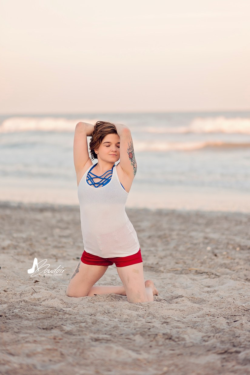 woman kneeling on beach