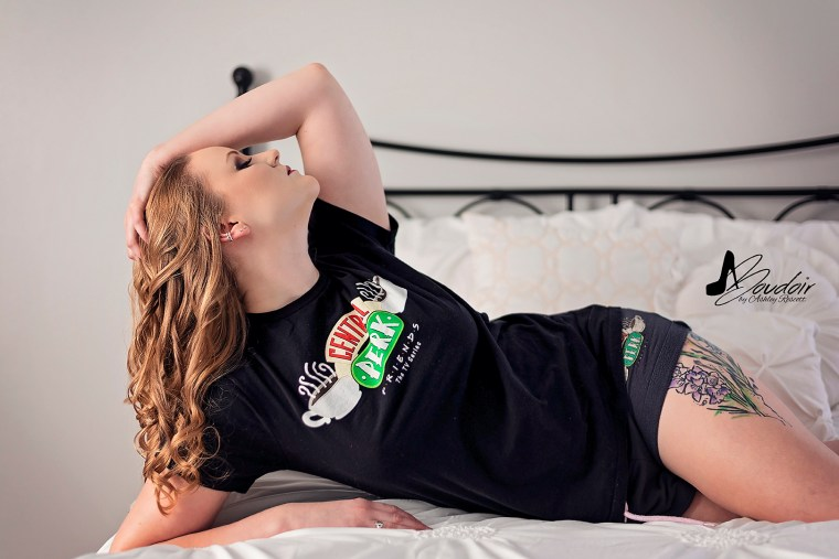 woman lounging in bed in t shirt & shorts